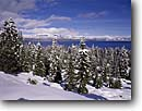 Stock photo. Caption: Lake Tahoe   and the Carson Range El Dorado National Forest Sierra Nevada,  California -- lakes united states america alpine peaks landscape landscapes mountains pristine national range ranges  travel tourist destination destinations sierras parks pure clean snow snowy winter snowfall covered