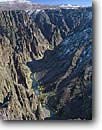 Stock photo. Caption: Gunnison River Black Canyon of the  Gunnison National Park Colorado Plateau, Colorado -- View rivers canyons parks rapid rapids wild and scenic gorge gorges united states america plateaus whitewater deep trust erosion eroded winter blue ribbon trout stream streams