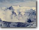 Stock photo. Caption: Aerial in winter    of the Southern Pickets North Cascades National Park North Cascade Range, Washington -- winter united states america mountain mountains glaciers northwest northwestern pacific state landscape landscapes peaks parks rock rocky alpine scenic wilderness wildernesses dramatic views view volcanic cones from airplane airplanes cold striking