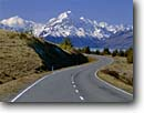 Stock photo. Caption: Lake Pukaki and Mount Cook Highway 80 at Peters Lookout Southern Alps South Island, New Zealand -- international world travel road highways roads highways mountain snow capped blue skies peaks curves curvy spring december roadside vacation trip drive destination traveler landscape landscapes destinations tourist scenic drive drives
