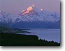 Stock photo. Caption: Lake Pukaki and Mt. Cook  from Peters Lookout Southern Alps South Island, New Zealand -- international world travel road highways highways mountain snow capped blue skies peaks spring december vacation trip destination traveler landscape landscapes destinations tourist scenic  majestic lakes peaks peak glacial glaciers alpenglow