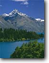 Stock photo. Caption: Lake Wakatipu and Mt. Turnbull Queenstown Southern Alps South Island, New Zealand -- summer travel destination destinations tourist attraction attractions peaceful peace international mountains mountain blue aqua snowcapped peaks peak lakes stunning breathtaking dramatic holiday sunny blue skies islands landscape landscapes scenics