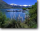 Stock photo. Caption: Lake Wanaka Wanaka Southern Alps South Island, New Zealand -- summer travel destination destinations tourist tourist attraction attractions peaceful peace international mountains mountain blue aqua boats boat snowcapped peaks peak lakes stunning breathtaking dramatic marina marinas dock docks