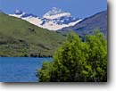 Stock photo. Caption: Glendhu Bay Lake Wanaka and Mt. Aspiring Southern Alps South Island, New Zealand -- summer travel destination destinations tourist tourist attraction attractions peaceful peace international mountains mountain blue aqua snowcapped peaks peak lakes stunning breathtaking dramatic sunny skies clear landscape landscapes scenics scenic