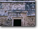 Stock photo. Caption: Mayan ruins from the Classic Period Doorway to Nunnery Annex Chichen Itza near Piste Yucatan,  Mexico -- international travel travels traveling Mexican north america ancient history historical tropical vacation spot vacations ruin temple  winter december national park persistance strength tourist building buildings archeological ornate door doors stone latin