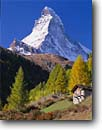 Stock photo. Caption: Old hut and the Matterhorn   from Zermatt Valais Canton The Valais Alps,  Switzerland -- peak peaks mountain mountains rural europe european destination travel tourist destinations world fall autumn attraction attractions climbing building buildings farming dairy blue skies clear majestic striking images scenics scenic landscapes alpine