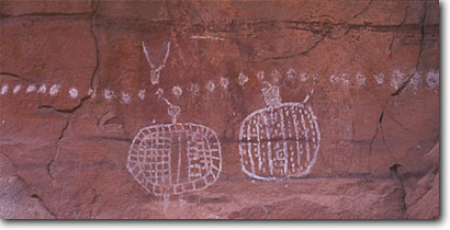 Stock photo. Caption: Two Turtles pictograph at Trail Arch Salt Creek Canyon Canyonlands National Park Colorado Plateau,  Utah -- united states pictographs rock anasazi native american ancient archeological site sites culture cultural communication archeology mysterious spiritual turtle petroglyphs panoramic panoramics panoramas panorama glyphs glyph animal animals representing