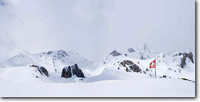 Stock photo. Caption: Panorama of the Swiss flag Heidelberger Hutte, Fimbertal/Val Fenga Silvretta Region Switzerland,  Europe -- solitude dramatic awesome snow mountains expanse cold winter scenic scenics landscape landscapes mountain extreme destination destinations alpine backcountry european europe panorama panoramic panoramas scene dramatic panoramics symbols